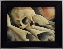 A watercolor painting of a skull resting atop a pile of femurs, from the catacombs below Paris by Janet Bray